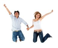 Lovely couple jumping Stock Images