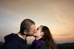Lovely couple kissing at sunset Royalty Free Stock Photography