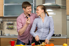 Lovely couple on kitchen Stock Image