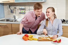 Lovely couple on kitchen Royalty Free Stock Image