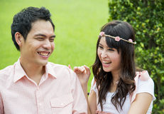 Lovely couple laugh in the garden2 Stock Photo
