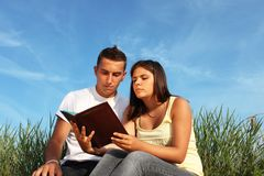 Lovely couple learning. Beautiful  couple learning together on a field Stock Photography