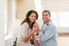Lovely couple looking at the camera Royalty Free Stock Image