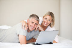 Lovely couple looking at the camera Royalty Free Stock Photo