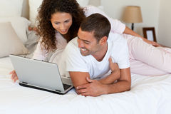 Lovely couple looking at their laptop Stock Photo