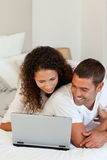 Lovely couple looking at their laptop Royalty Free Stock Image
