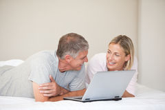 Lovely couple looking at their laptop Stock Image