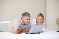 Lovely couple looking at their laptop Royalty Free Stock Photography
