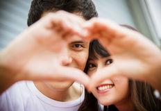 Lovely couple with love hand sign Stock Images