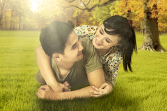 Lovely couple lying at autumn park Royalty Free Stock Photography