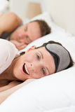 Lovely couple lying down in their bed Royalty Free Stock Photo