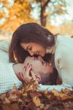 Gentle couple lying in the park and kising royalty free stock images