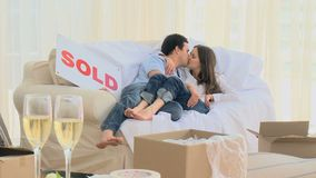 Lovely couple lying on the sofa and kissing each other. At new home stock footage