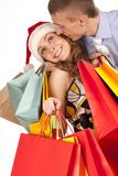 Lovely couple making christmas shopping Stock Photo
