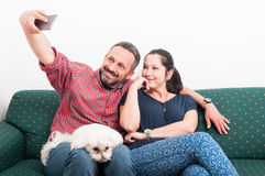 Lovely couple making selfie with their dog Royalty Free Stock Image