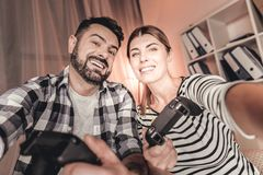 Lovely couple making selfies at home Stock Images