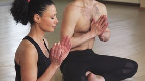 Close up of a couple meditating together in lotus position stock image