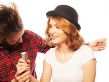 Lovely couple with microphone Royalty Free Stock Photography