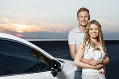 Lovely couple near the car Royalty Free Stock Photography
