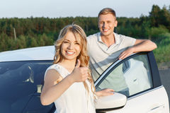 Lovely couple near the car Stock Images