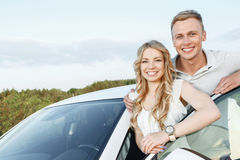Lovely couple near the car royalty free stock images