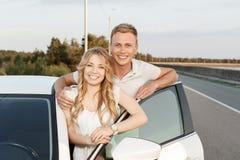 Lovely couple near the car Stock Image