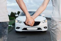 Lovely couple near the car Stock Photography