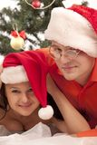 Lovely couple near a Christmas tree Royalty Free Stock Photography