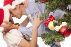 Lovely couple near a Christmas tree Stock Photo