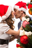 Lovely couple near a Christmas tree Royalty Free Stock Photography
