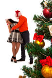 Lovely couple near a Christmas tree Royalty Free Stock Photos