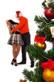 Lovely couple near a Christmas tree Royalty Free Stock Photos