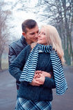 Lovely couple in the park. Man hugging his girlfriend stock photos