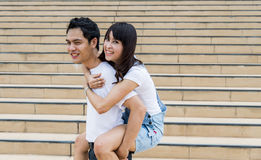 Lovely couple piggy back ride on the stairs1 Royalty Free Stock Photos