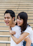 Lovely couple piggy back ride on the stairs2 Royalty Free Stock Photography