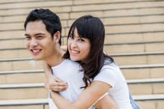 Lovely couple piggy back ride on the stairs3 Royalty Free Stock Photo
