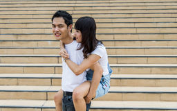 Lovely couple piggy back ride on the stairs4 Stock Image