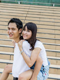 Lovely couple piggy back ride on the stairs5 Royalty Free Stock Photo