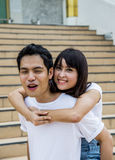 Lovely couple piggy back ride on the stairs6 Stock Photos