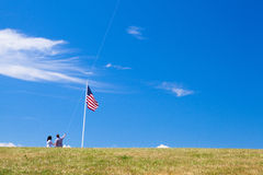 Lovely couple play with air kite near Portland Head Light in Cap Royalty Free Stock Photos