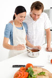 Lovely couple preparing a bolognese sauce together Royalty Free Stock Images