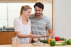 Lovely couple preparing a sauce Stock Photos