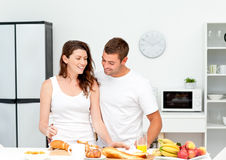 Lovely couple preparing their breakfast together Stock Photo