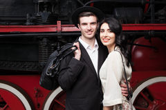 Lovely couple on railway station Royalty Free Stock Images
