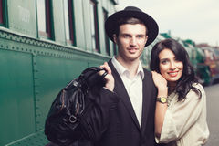 Lovely couple on railway station Royalty Free Stock Photo