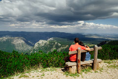 Lovely couple relax on peak of mountains back view Stock Photo