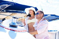 Lovely couple relaxing on a boat on a vacation woth shampagne Royalty Free Stock Photography