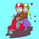 Lovely couple riding a red scooter Royalty Free Stock Photo