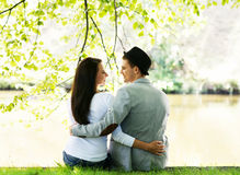 Lovely couple on a romantic date in a park Royalty Free Stock Photography