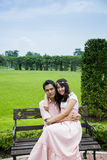 Lovely couple sit in the garden1 Royalty Free Stock Photography